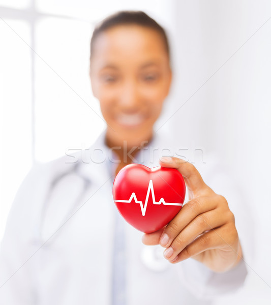 female doctor holding red heart with ecg line Stock photo © dolgachov