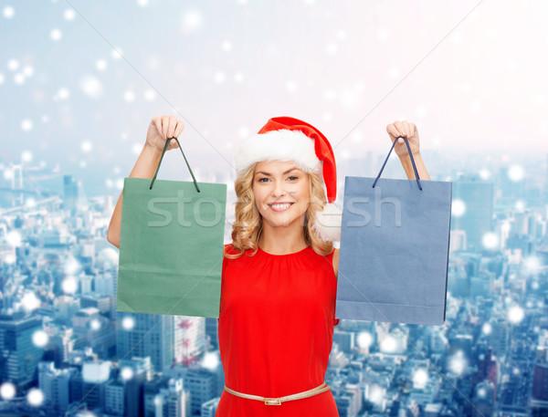 Nő mikulás segítő kalap bevásárlótáskák vásár Stock fotó © dolgachov