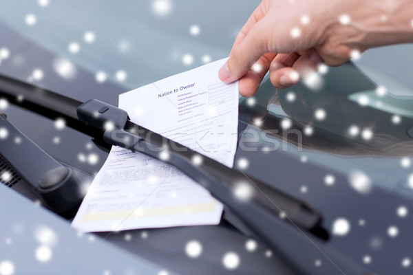 close up of male hand with parking ticket on car Stock photo © dolgachov