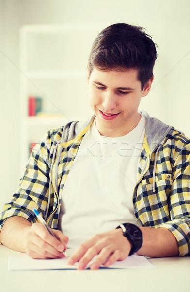 smiling student with textbooks at school Stock photo © dolgachov