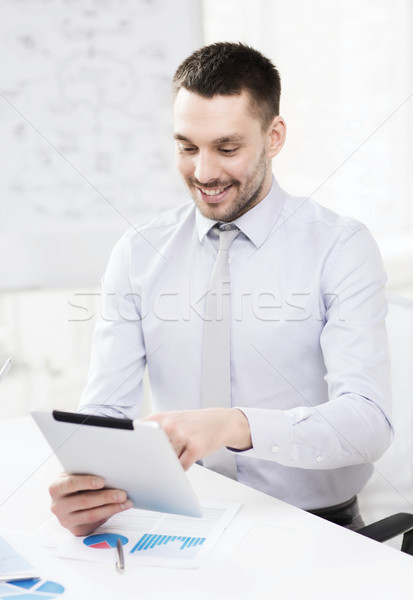 businessman with tablet pc and files in office Stock photo © dolgachov