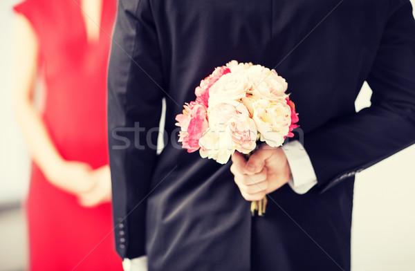 ストックフォト: 男 · 隠蔽 · 花束 · 花 · 後ろ · 戻る