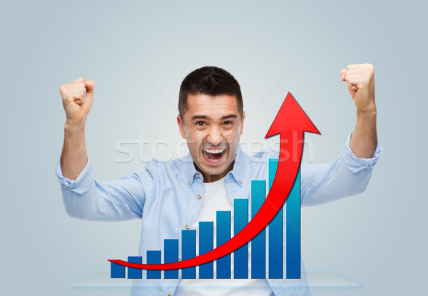happy laughing man with raised hands Stock photo © dolgachov