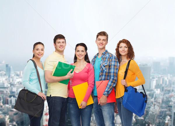 Grupo sonriendo adolescentes amistad educación personas Foto stock © dolgachov