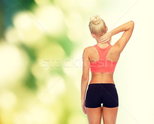 Deportivo mujer tocar cuello fitness salud Foto stock © dolgachov