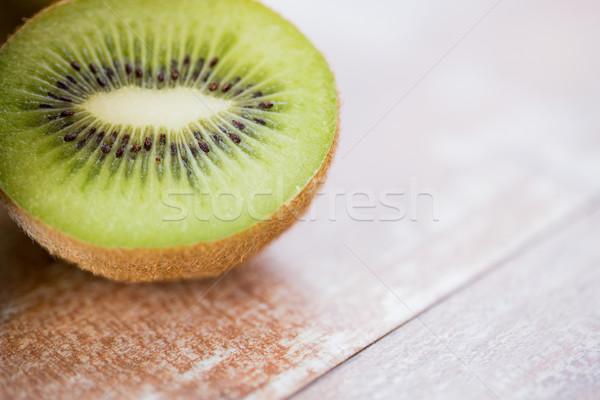 close up of ripe kiwi slice on table Stock photo © dolgachov