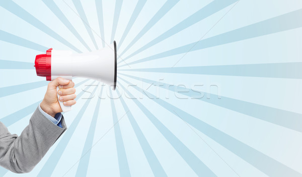 business man hand holding megaphone Stock photo © dolgachov