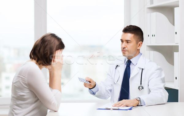 doctor giving pills to woman at hospital Stock photo © dolgachov