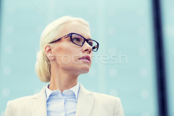 young businesswoman over office building Stock photo © dolgachov