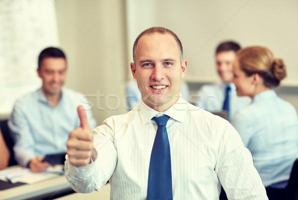 Foto stock: Grupo · sonriendo · reunión · oficina · gente · de · negocios