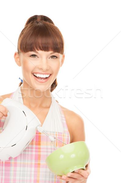 housewife with mixer Stock photo © dolgachov