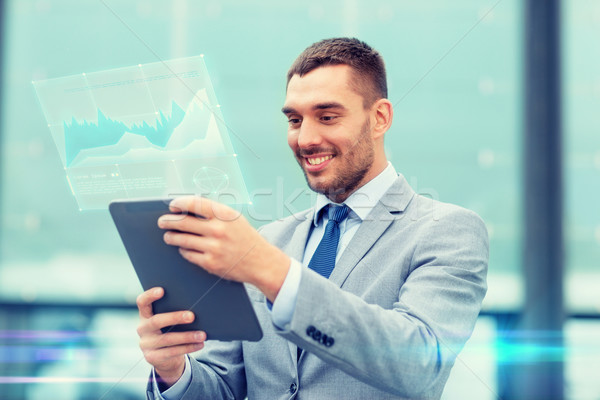 smiling businessman with tablet pc outdoors Stock photo © dolgachov