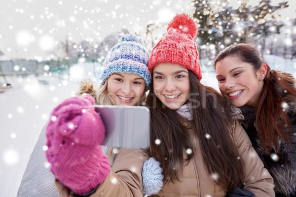 happy teenage girls taking selfie with smartphone Stock photo © dolgachov