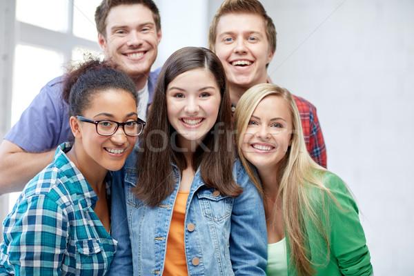 Groep gelukkig middelbare school studenten klasgenoten onderwijs Stockfoto © dolgachov