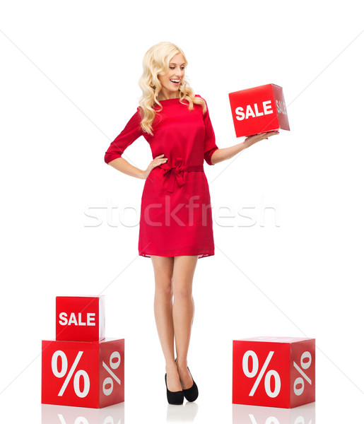 smiling woman in red dress with shopping signs Stock photo © dolgachov