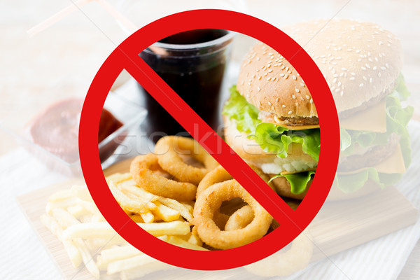 close up of fast food and drink behind no symbol Stock photo © dolgachov