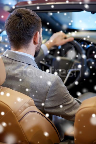 close up of man in cabrio car at auto show Stock photo © dolgachov