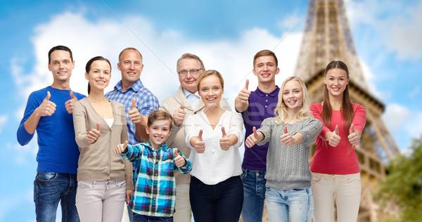 Sorridente pessoas Torre Eiffel gesto Foto stock © dolgachov