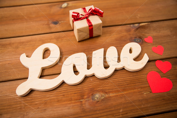close up of word love with gift box and red hearts Stock photo © dolgachov
