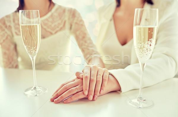 Közelkép leszbikus pár pezsgő szemüveg emberek Stock fotó © dolgachov