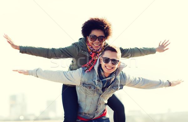 happy teenage couple in shades having fun outdoors Stock photo © dolgachov