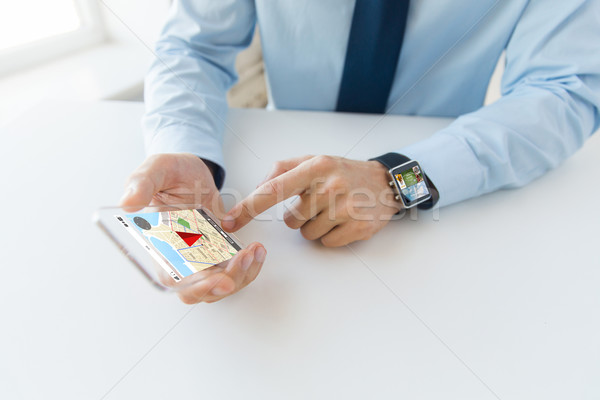 close up of hands with smart phone and watch Stock photo © dolgachov
