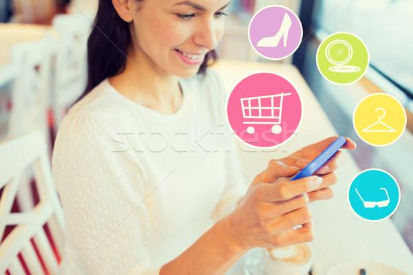 улыбающаяся женщина смартфон торговых онлайн люди Сток-фото © dolgachov