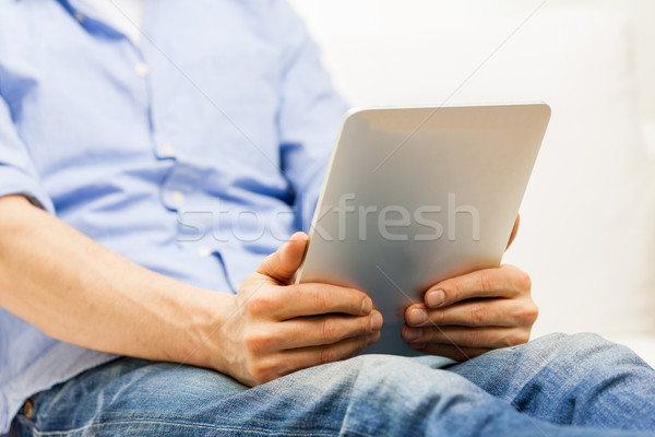 close up of man working with tablet pc at home Stock photo © dolgachov