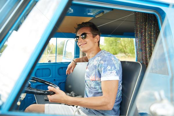Mosolyog fiatal hippi férfi vezetés mikrobusz Stock fotó © dolgachov