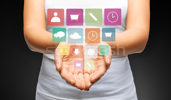 close up of womans hands with app menu icons Stock photo © dolgachov