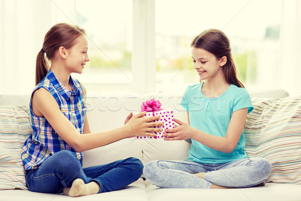 happy little girls with birthday present at home Stock photo © dolgachov