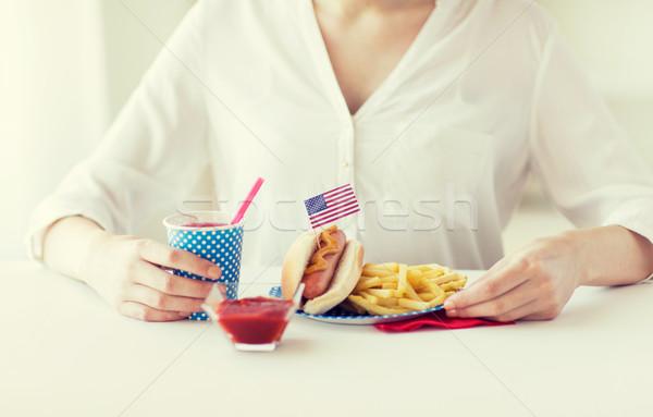 close up of woman eating hotdog and french fries Stock photo © dolgachov