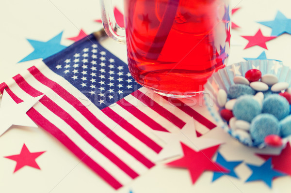 juice glass and american flag on independence day Stock photo © dolgachov