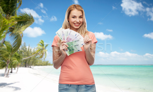 happy young woman with euro cash money Stock photo © dolgachov