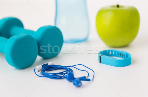 close up of dumbbells, pulse tracker and earphones Stock photo © dolgachov
