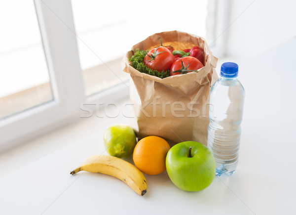 basket of vegetable food and water at kitchen Stock photo © dolgachov