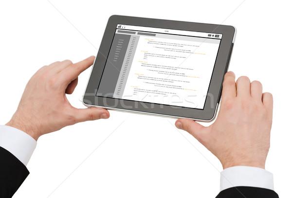 Közelkép kezek tart táblagép kódolás üzletemberek Stock fotó © dolgachov