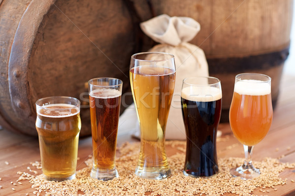 Stock photo: close up of beer barrel, glasses and bag with malt