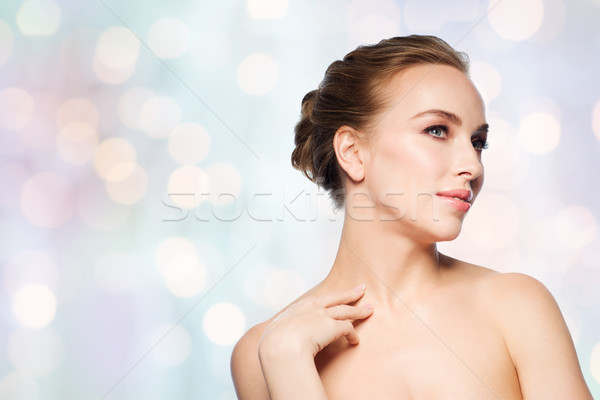 beautiful young woman touching her neck Stock photo © dolgachov
