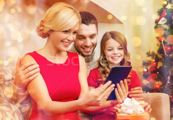 smiling family with tablet pc Stock photo © dolgachov