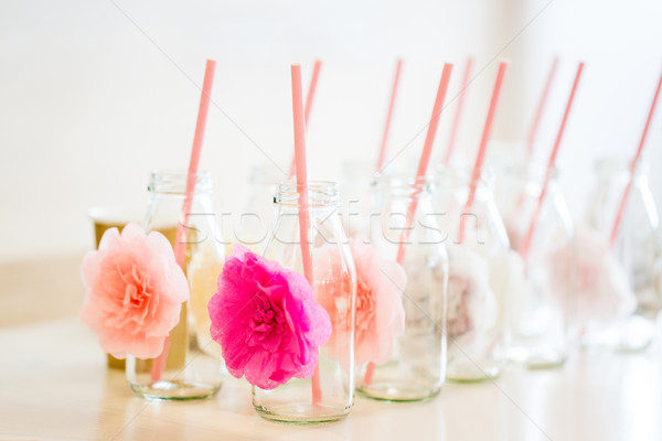 close up of glass bottles for drinks with straws Stock photo © dolgachov