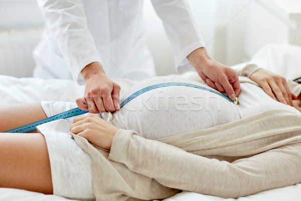 close up of doctor and pregnant woman at hospital Stock photo © dolgachov