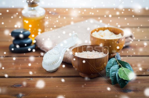 himalayan pink salt, massage brush and bath towel Stock photo © dolgachov