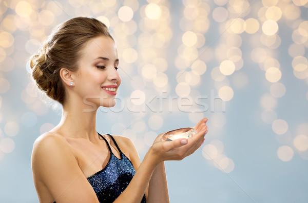 smiling woman in evening dress holding diamond Stock photo © dolgachov