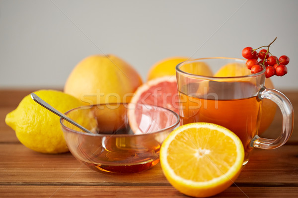 tea with honey, lemon and rowanberry on wood Stock photo © dolgachov