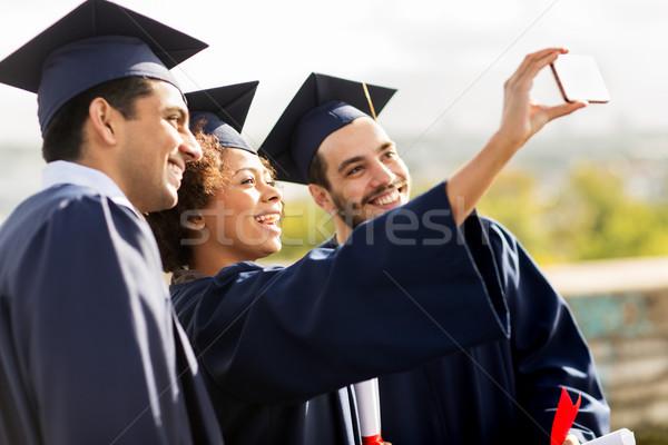 Stockfoto: Studenten · bachelors · smartphone · onderwijs · afstuderen
