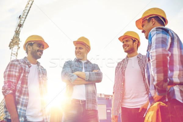 Grupo sorridente construtores ao ar livre negócio edifício Foto stock © dolgachov