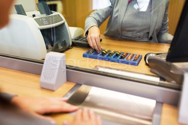 clerk counting cash money at bank office Stock photo © dolgachov