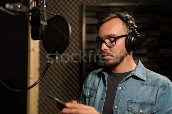 Férfi fejhallgató zene zenei stúdió előadás üzletemberek Stock fotó © dolgachov