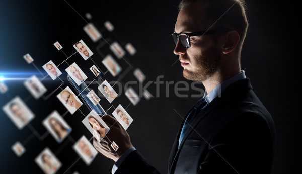 close up of businessman with tablet pc and icons Stock photo © dolgachov